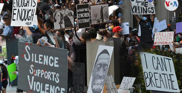Miles marchan de manera pacífica en Houston por la muerte de George Floyd